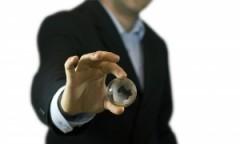 businessman-holding-crystal-globe-1281812-m