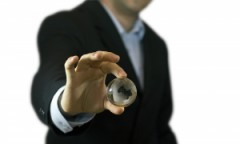 businessman-holding-crystal-globe-1281812-m